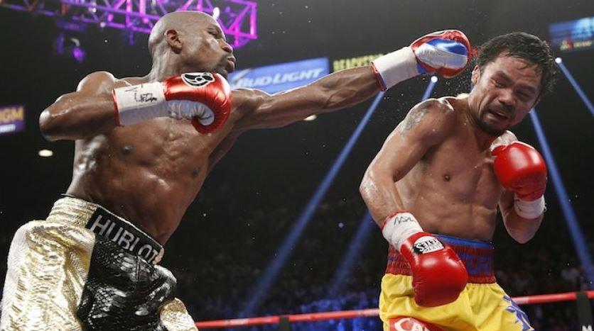 Por decisión unánime, Mayweather gana la pelea del siglo a Pacquiao