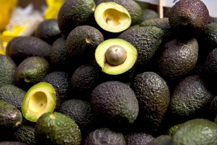 Some avocado wholes and halves.