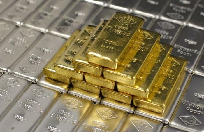 En descenso precio del Oro y Plata